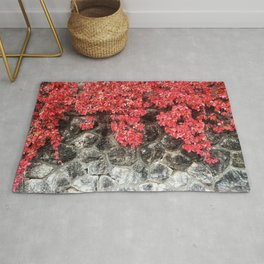 Pink red ivy leaves autumn stone wall Rug