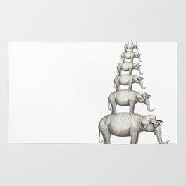 7 elefantes con gafas Rug