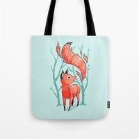 trees Tote Bags featuring Winter Fox by Freeminds