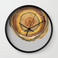 tree rings Wall Clocks featuring Tree Rings by Rachael Shankman