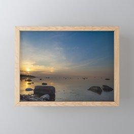 Sun with faint halo over the calm sea and reef rocks Framed Mini Art Print