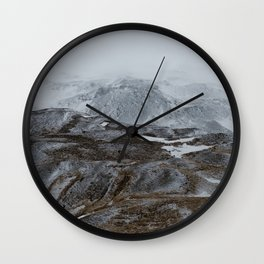 Layers of snowy montains Wall Clock