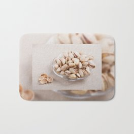 open pistachio nuts in shell Bath Mat