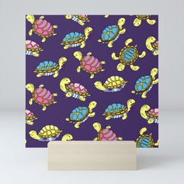 Turtles on purple Mini Art Print