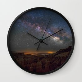 Night sky over canyon Wall Clock