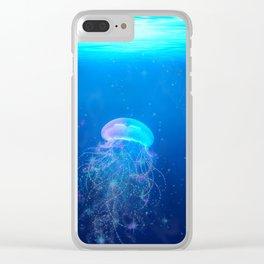 Glowing and sparkling blue jellyfish swimming in mystical deep blue ocean Clear iPhone Case