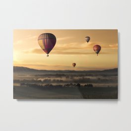 Hot Air Balloons Floating Over a Foggy Landscape Metal Print