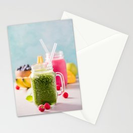 Close-up of green fresh smoothie with fruits, berries, oats and seeds, selective focus Stationery Cards