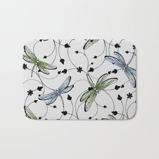Dragonflies in the garden Bath Mat