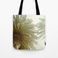 palm trees Tote Bags featuring Palm Trees by The ShutterbugEye
