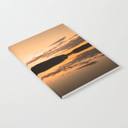 Beautiful sunset - glowing orange - forest silhouette and reflection Notebook