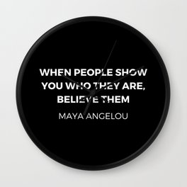 Maya Angelou Inspiration Quotes - When people show you who they are believe them Wall Clock