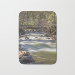 A bridge over the Merced River stands solidly over the velvety exposure of the water Bath Mat