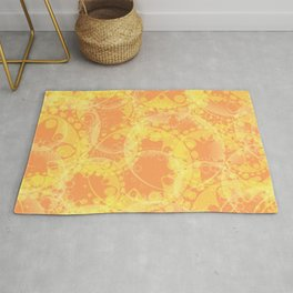 Spring pastels gently orange and yellow circles and ellipses with the image of abstract flowers. Rug