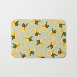 Yellow Citrus Lemon Fruit on Pale Lime Green Bath Mat