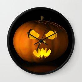 II - Halloween pumpkin on a black reflective surface Wall Clock
