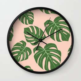 Monstera with pink background Wall Clock