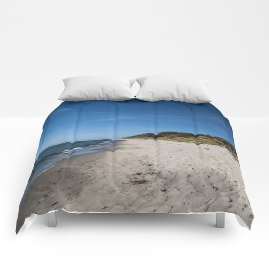 Rough seascape Comforters