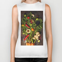 fresh carrots bunch, herbs and spices on dark rustic background Biker Tank