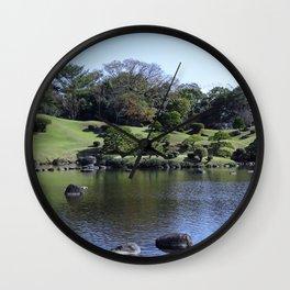 tranqul lake in a Japanese garden Wall Clock