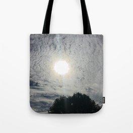 sun behind clouds Tote Bag