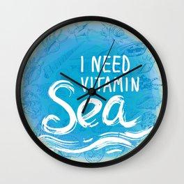 i need vitamin sea White text on blue background, Summer sea shells, molluscs Wall Clock