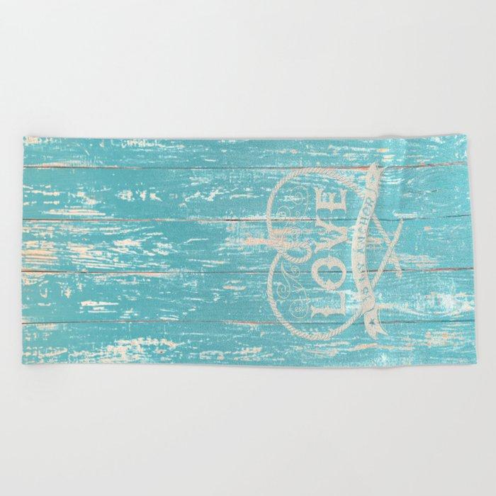 Maritime Design- Love is my anchor on aqua grunge wood background Beach Towel