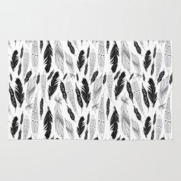 raphic pattern feathers on a white background Rug