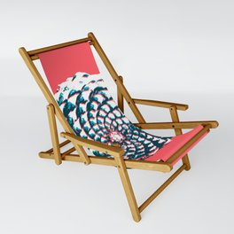 pine cone pattern in coral, aqua and indigo Sling Chair