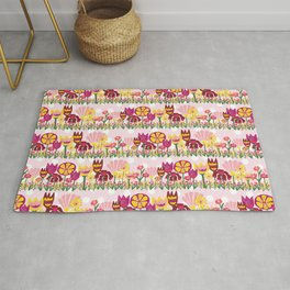 Flower meadow. Yellow, purple, and pink flowers on pink and white polka dot background. Rug