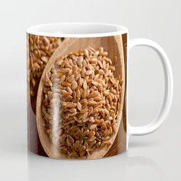 Brown linseeds portion on wooden spoon Coffee Mug