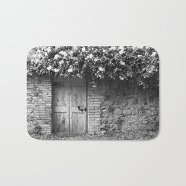 Old Italian wall overgrown with roses Bath Mat