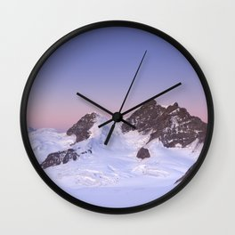 Dawn at the Jungfrau peak from Jungfraujoch in Switzerland Wall Clock