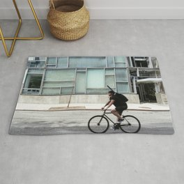 Cyclist riding in New York City Rug