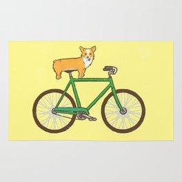 Corgi on a bike Rug