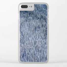 Ice and snow covered pine trees in a dense forest Clear iPhone Case