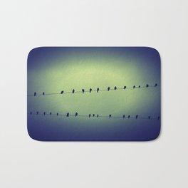 birds on a wire Bath Mat
