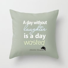 A day without laughter is a day wasted - Charlie Chaplin Quote Throw Pillow