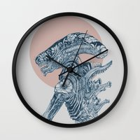 xenomorph Wall Clocks featuring Floral Alien by Marie Toh