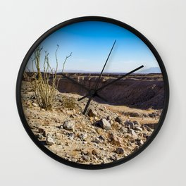 Lone Ocotillo Reaching up to the Blue Sky in front of a Gorge in the Anza Borrego Desert State Park Wall Clock