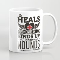 health Mugs featuring He health the brokenhearted by biblebox