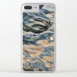 Abstract eroded rocks on beach with puddle Clear iPhone Case