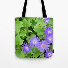 Purple flowers on leafy greens Tote Bag