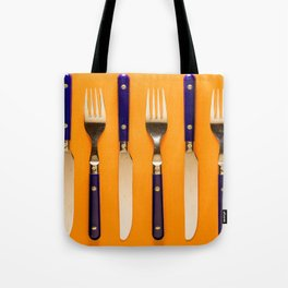 blue forks and knives on orange background Tote Bag