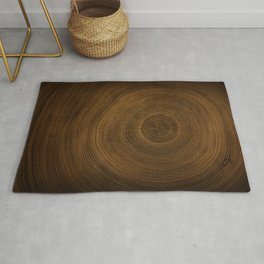 Detailed rich dark brown cut wood tree with growth rings pattern Rug