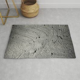 Holes in the cement surface Rug