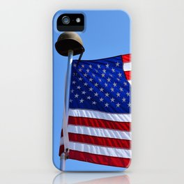 United States flag waving with a military helmet on the mast iPhone Case