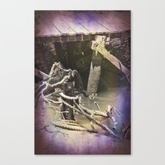 Old wharf and ropes on a river. Canvas Print