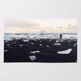 Photographer on Diamond Beach, Iceland Rug