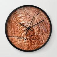tree rings Wall Clocks featuring Tree Rings by rebecca haegele